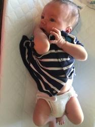 Newborn in a fitted diaper